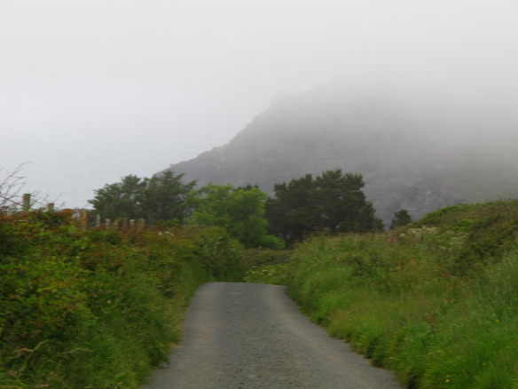 Marginally relevant photo: fog stealing the top of the cliff